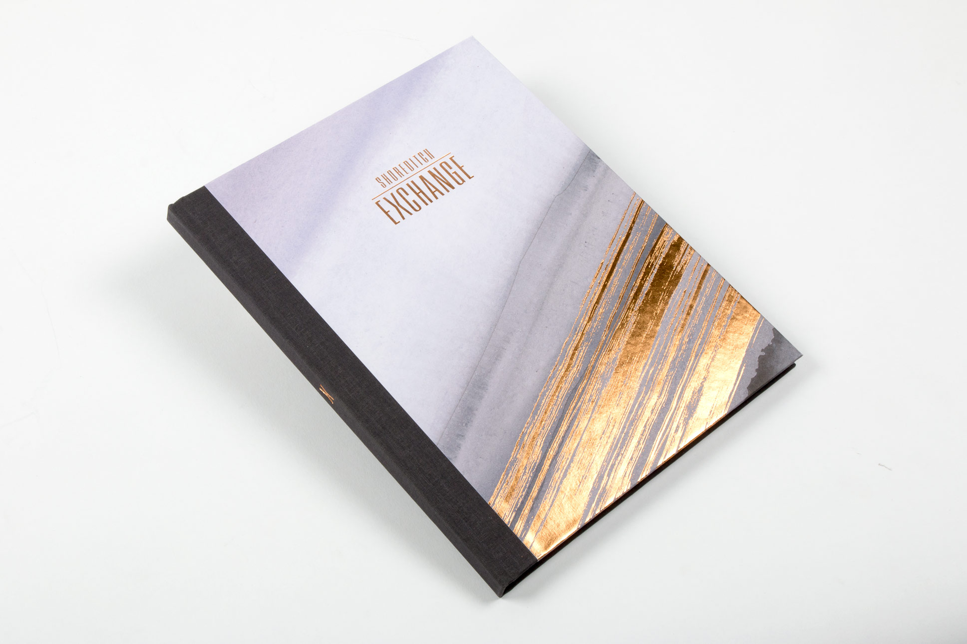 case bound property coffee table book with gold foil