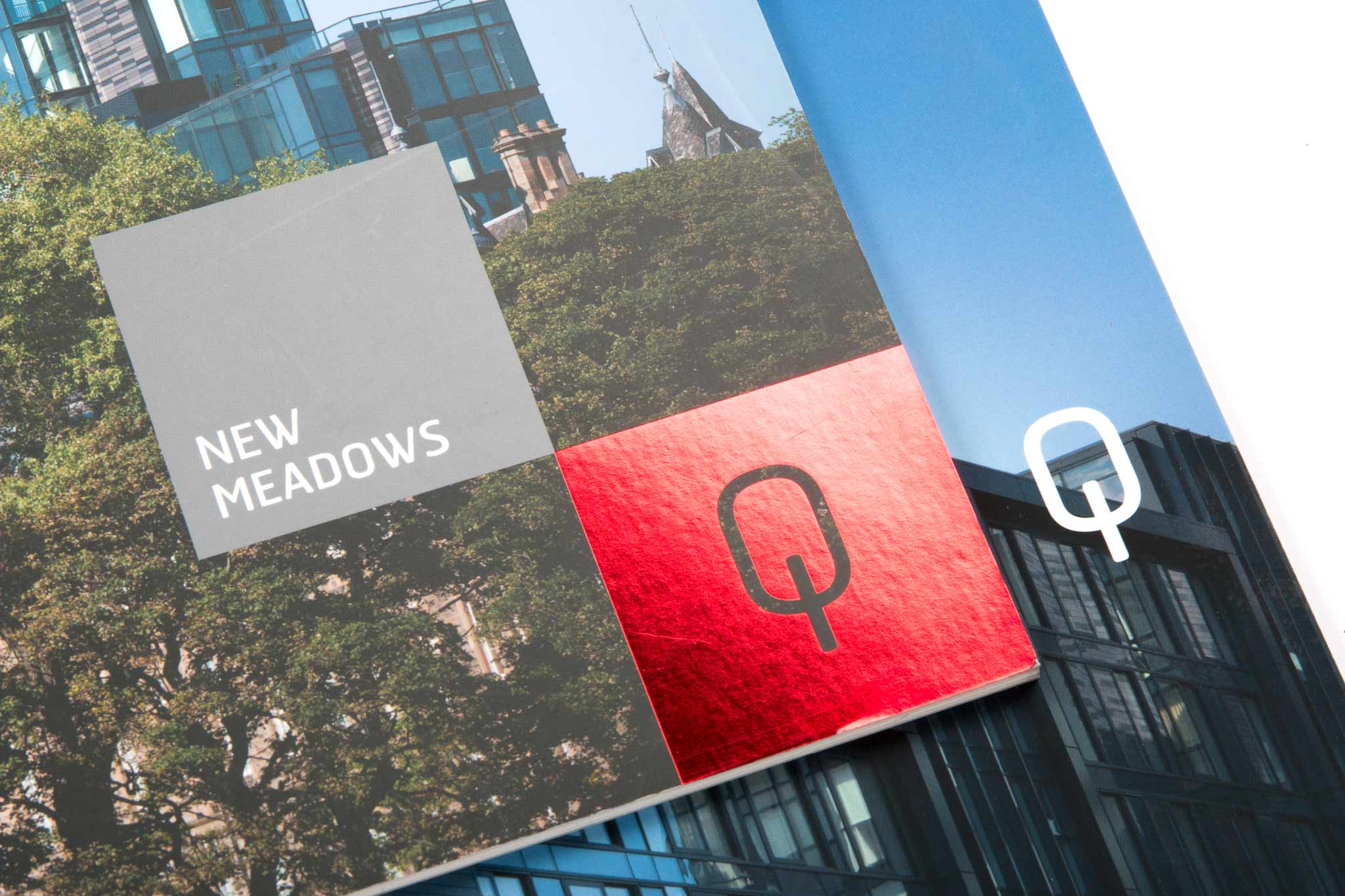printed property brochure with red foil block